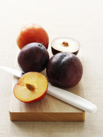 nourishing: Sliced plums on cutting board