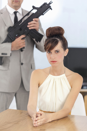 Woman and boyfriend with machine gun