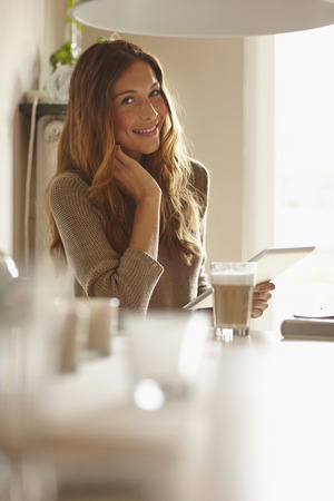Smiling woman using tablet computer