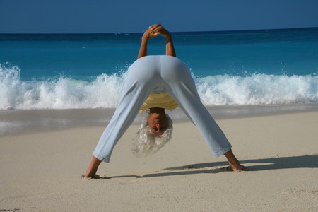 spiritual beings: Woman practicing yoga on tropical beach