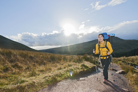 brecon beacons: Hiker walking up gravel path