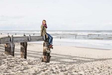 seascapes: Woman on abandoned pier on beach