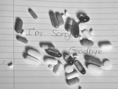notations: Handful of pills on suicide note
