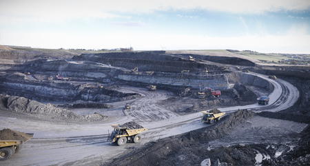 mined: Trucks at surface coal mine site