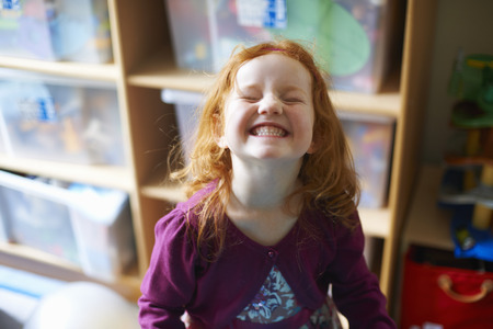 silliness: Girl making face in playroom