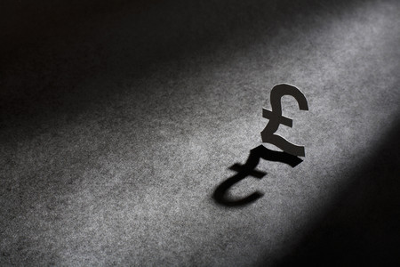 liable: Metal pound sign casting shadow