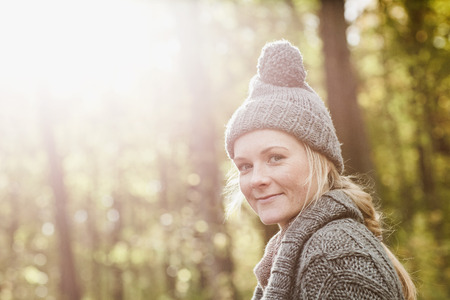 Smiling woman walking in forest