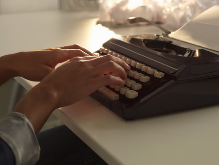 Close up of woman using typewriter