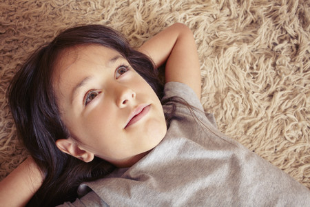 coverings: Girl laying on shag carpet