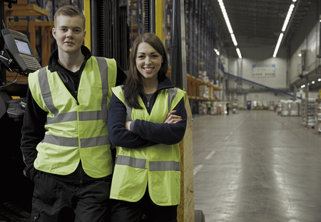 shipped: Workers by forklift in warehouse LANG_EVOIMAGES