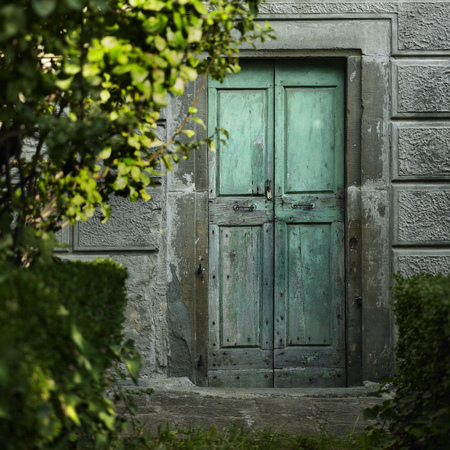 no entrance: Old doors in concrete wall