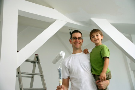 cherished: Father and son painting new house LANG_EVOIMAGES