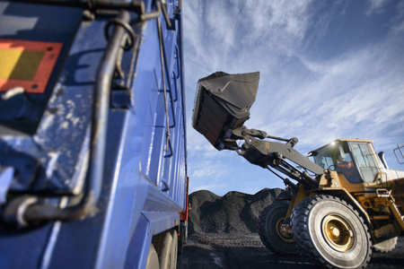 mined: Worker driving excavator at coal mine