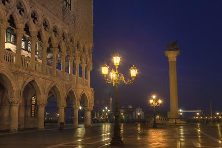 mediterranean culture: City lights reflected on wet street