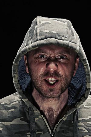frowns: Grimacing man wearing hoodie