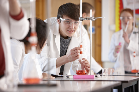 Students working in chemistry lab LANG_EVOIMAGES