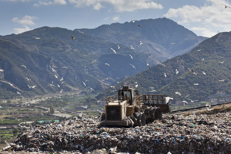 egglayer: Machinery working on waste in landfill
