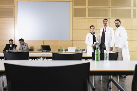 gather: Doctors and businessmen in meeting room