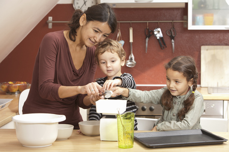 worktops: Mother and children cooking in kitchen