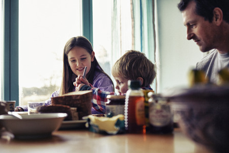 nourishing: Family eating together at table LANG_EVOIMAGES
