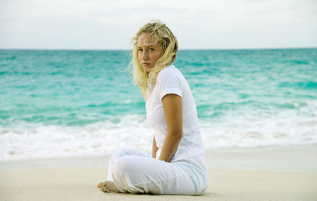 Woman sitting on tropical beach