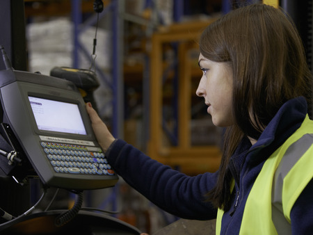 shipped: Worker operating forklift in warehouse LANG_EVOIMAGES