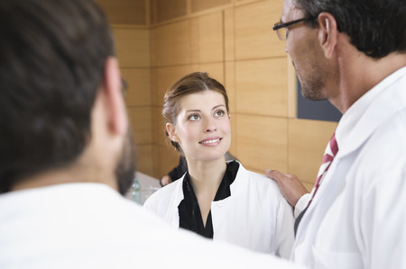 Doctors talking in conference room