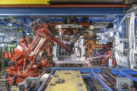 assembled: Robots welding van body in car factory LANG_EVOIMAGES