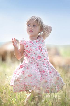 frock: Girl walking in tall grass