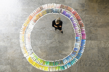 consulted: Businesswoman examining paint swatches