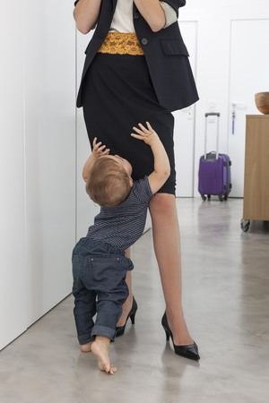 Toddler boy greeting mother in hallway LANG_EVOIMAGES