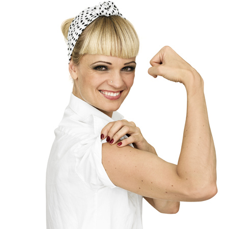 Smiling woman flexing arm muscle LANG_EVOIMAGES