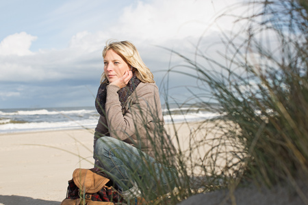 musing: Woman sitting on beach
