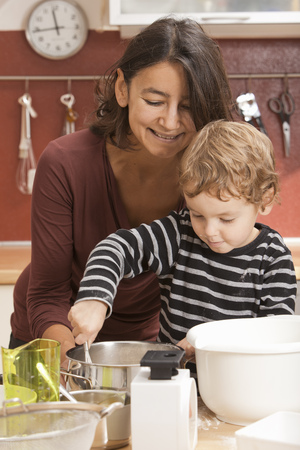 worktops: Mother and son cooking in kitchen