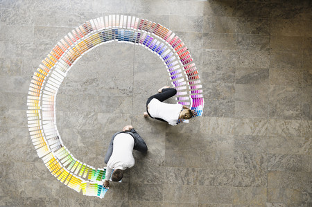 conferring: Business people examining paint swatches LANG_EVOIMAGES