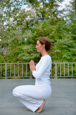 spiritual beings: Woman practicing yoga outdoors LANG_EVOIMAGES