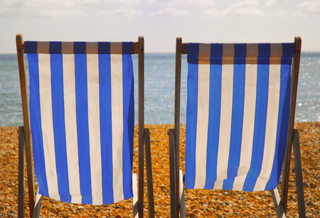 Perfect Empty Lawn Chairs On Rocky Beach Stock Photo   80657501