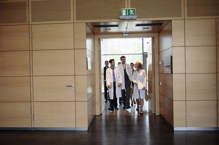 gather: Doctors walking in office hallway