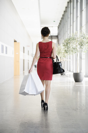 Businesswoman walking in lobby LANG_EVOIMAGES