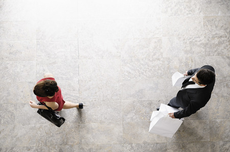 pursued: Overhead view of business people walking