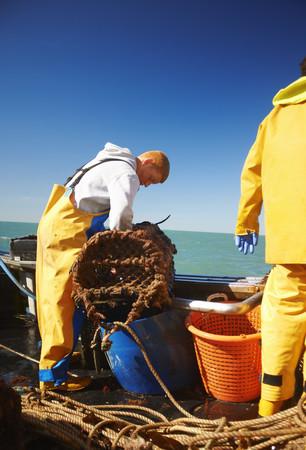 Fishermen at work on boat LANG_EVOIMAGES