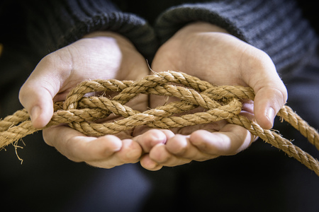 Student tying carrick bend knot in rope LANG_EVOIMAGES