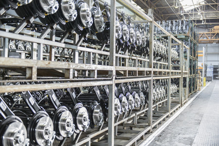 industrialization: Shelves of axles in car factory LANG_EVOIMAGES