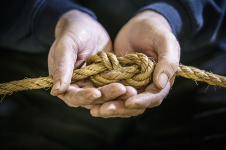 fastened: Student tying figure eight in rope