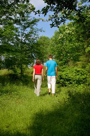 truelove: Couple walking in meadow
