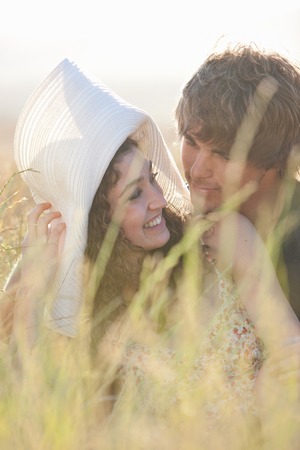 sweethearts: Couple relaxing in tall grass