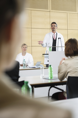 gather: Doctors giving talk in conference room