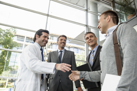 gather: Doctor and businessman shaking hands
