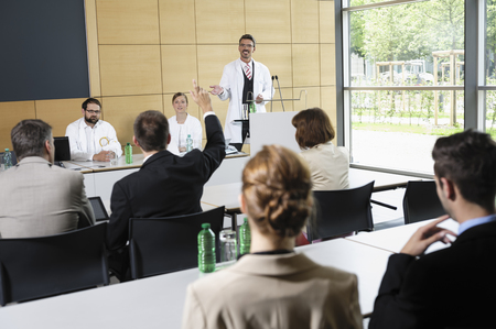 interrogations: Doctors giving talk in conference room