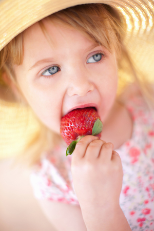 morsels: Close up of girl eating strawberry